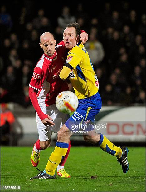 Bart Goor of KVC Westerlo is challenged for the ball by Laurent Ciman of Standard Liege during the Jupiler League match between Westerlo and Standard...