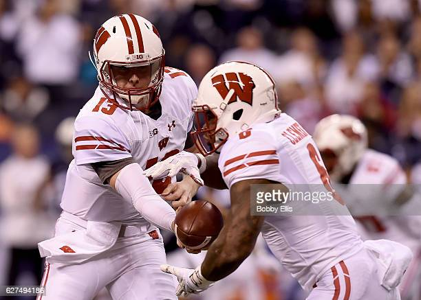 Bart Houston of the Wisonsin Badgers hands off the ball to Corey Clement of the Wisonsin Badgers during the first quarter of the Big Ten Championship...
