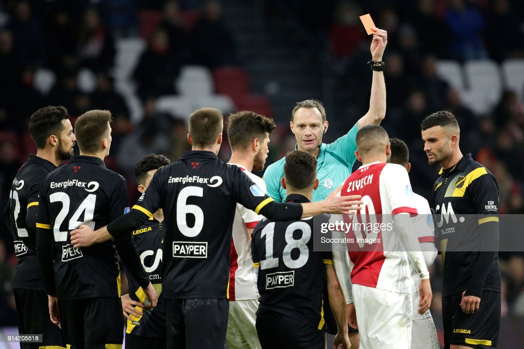 Bart Meijers of NAC Breda receives a red card from referee Ed Janssen during the Dutch Eredivisie match between Ajax v NAC Breda at the Johan Cruijff Arena on February 4, 2018 in Amsterdam Netherlands