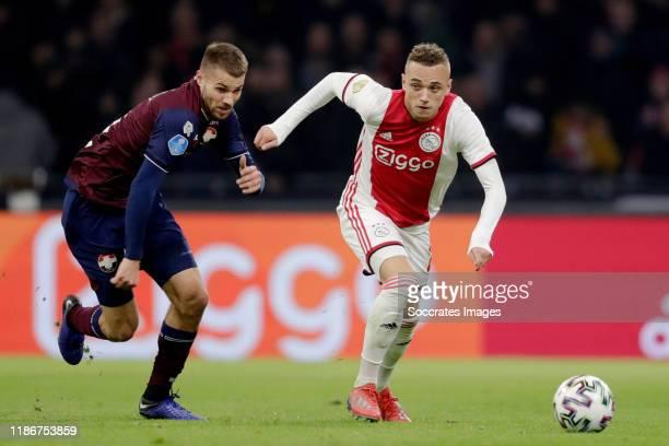 Bart Nieuwkoop of Willem II Noa Lang of Ajax during the Dutch Eredivisie match between Ajax v Willem II at the Johan Cruijff Arena on December 6 2019...