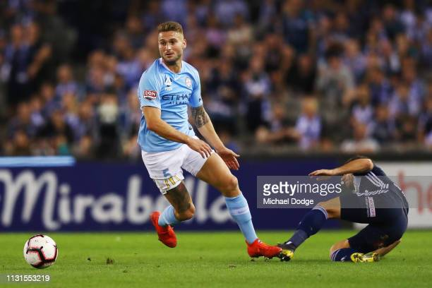 Bart Schenkenveld of the City keeps away Kosta Barbarouses of the Victory during the Round 20 match between Melbourne Victory and Melbourne City at...