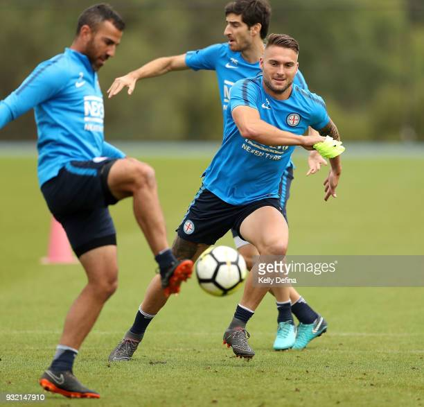 Bart Schenkeveld defends Manny Muscat both of Melbourne City as he kicks the ball during a Melbourne City FC ALeague training session at City...