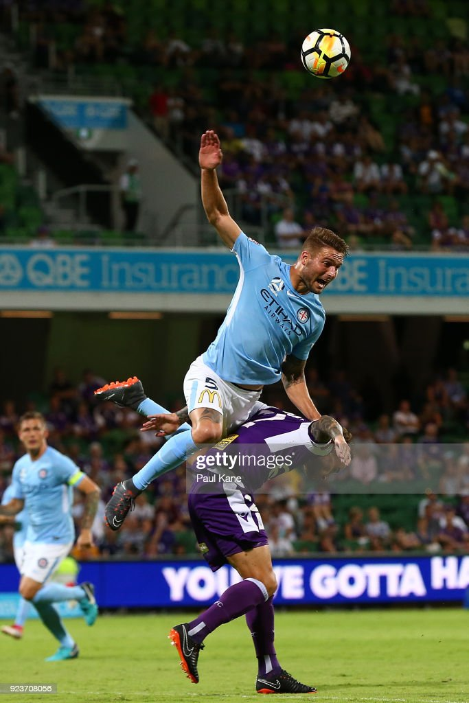 Bart Schenkeveld of Melbourne challenges Andy Keogh of the Glory for the ball during the round 21 A-League match between the Perth Glory and Melbourne City FC at nib Stadium on February 24, 2018 in Perth, Australia.