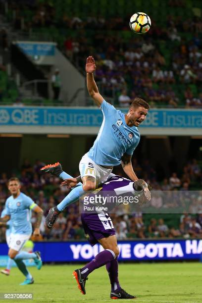 Bart Schenkeveld of Melbourne challenges Andy Keogh of the Glory for the ball during the round 21 ALeague match between the Perth Glory and Melbourne...