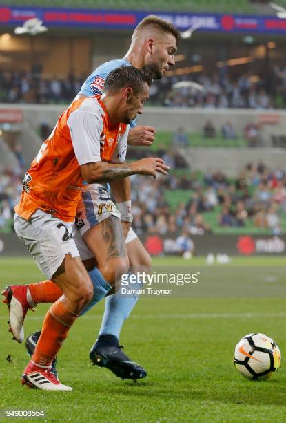 Bart Schenkeveld of Melbourne City and Eric Bautheac of the Roar compete during the ALeague Elimination Final match between the Melbourne City and...