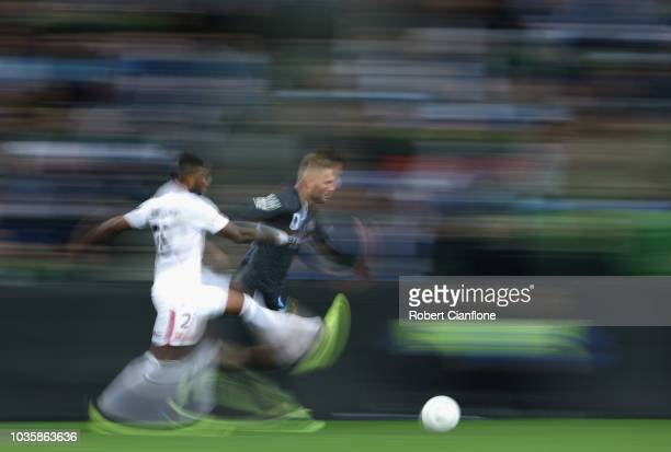Bart Schenkeveld of the Melbourne City is chased by Rolieny Bonevacia of the Wanderers during the FFA Cup quarterfinal match between Melbourne City...