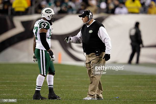 Bart Scott of the New York Jets talks with head coach Rex Ryan during the second half against the Philadelphia Eagles at Lincoln Financial Field on...