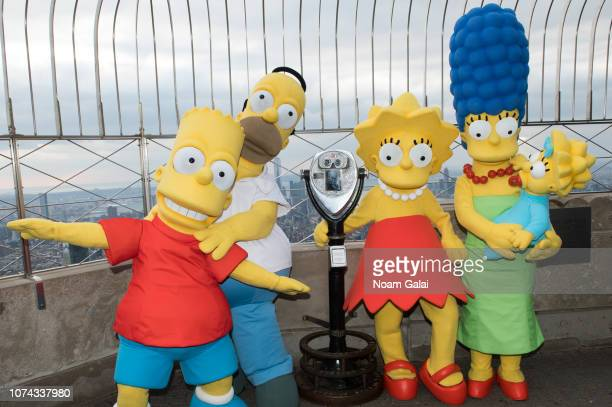 Bart Simpson Homer Simpson Lisa Simpson Marge Simpson and Maggie Simpson visit The Empire State Building to celebrate the 30th anniversary of The...