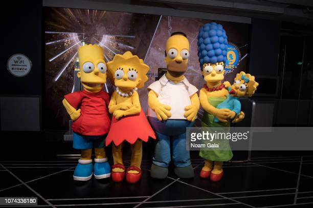 Bart Simpson Lisa Simpson Homer Simpson Marge Simpson and Maggie Simpson visit The Empire State Building to celebrate the 30th anniversary of The...