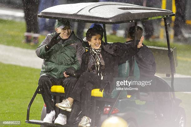 Bart Starr former Green Bay Packers quarterback and his spouse Cherry Louise Morton wave to the crowd during the jersey retirement ceremony for Brett...