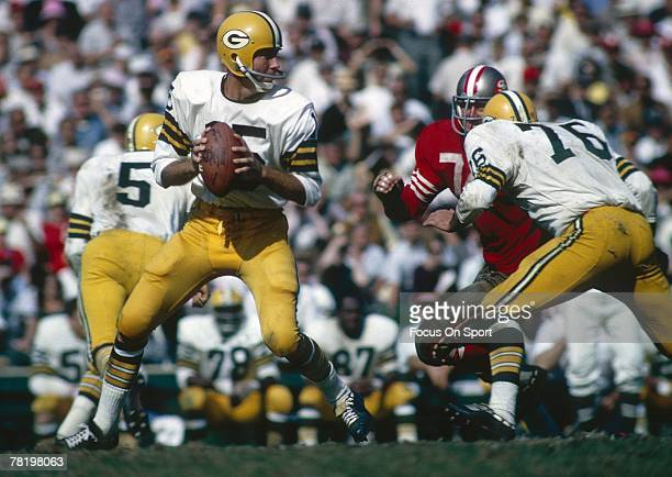 Bart Starr of the Green Bay Packers drops back to pass against the San Francisco 49ers during a circa 1960's NFL game