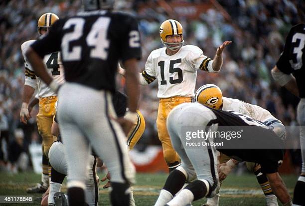 Bart Starr of the Green Bay Packers looks on at the line of scrimmage against the Oakland Raiders during Super Bowl II January 14 1968 at the Orange...