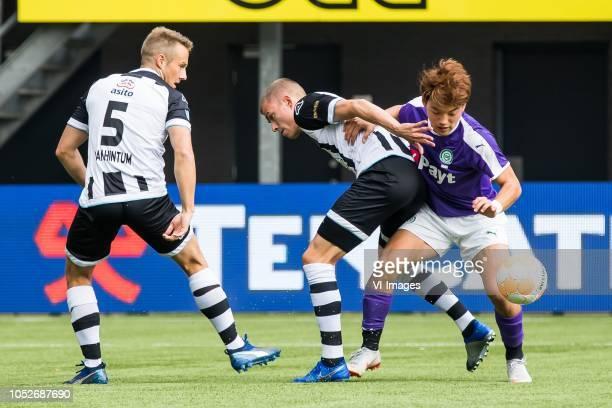 Bart van Hintum of Heracles Almelo Dario van den Buijs of Heracles Almelo Ritsu Doan of FC Groningen during the Dutch Eredivisie match between...
