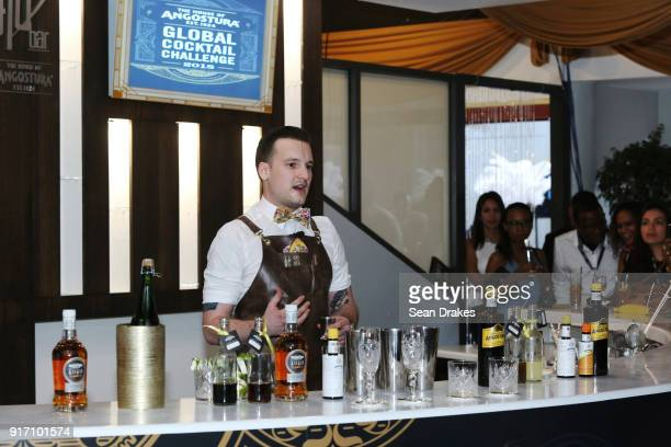 Bartender Alexander Kirles of the United States creates two original cocktails for judges using Angostura products during the Angostura Global...