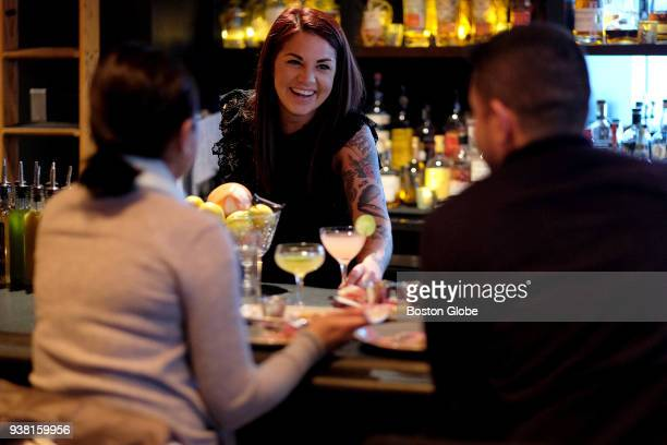 Bartender and assistant general manager Jacki Schromm serves drinks at Lion's Tail in Boston on March 23 2018 As dating apps like Tinder and Bumble...