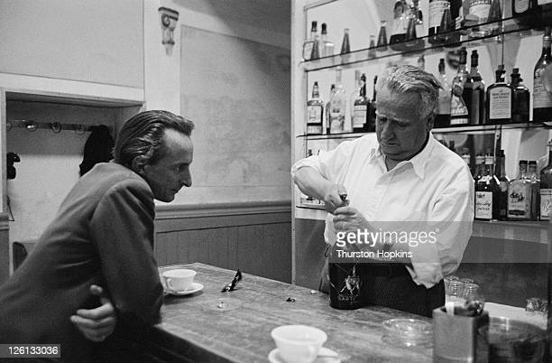 A bartender and customer in a bar in the Tuscan hill town of San Gimignano Italy August 1955 Original publication Picture Post 7958 Open Air Theatre...