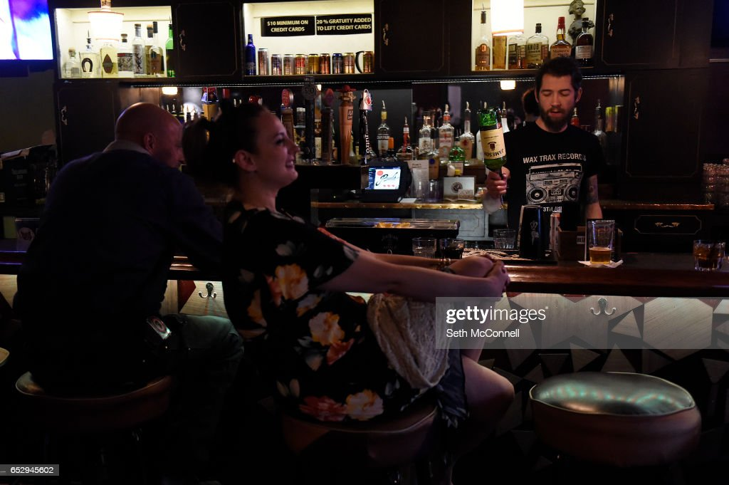 Bartender Austin Lane Latham serves drinks at Your Mom's House on March 9, 2017 in Denver, Colorado. Your Mom's House is Denver's newest concert venue with a full menu of wine and spirits.