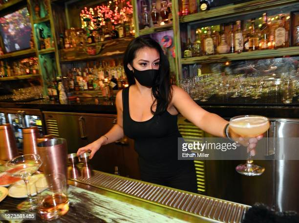 Bartender Brandi Sterner makes drinks after the bartop opened for the first time at Lucky Day bar in the Fremont East Entertainment District on...