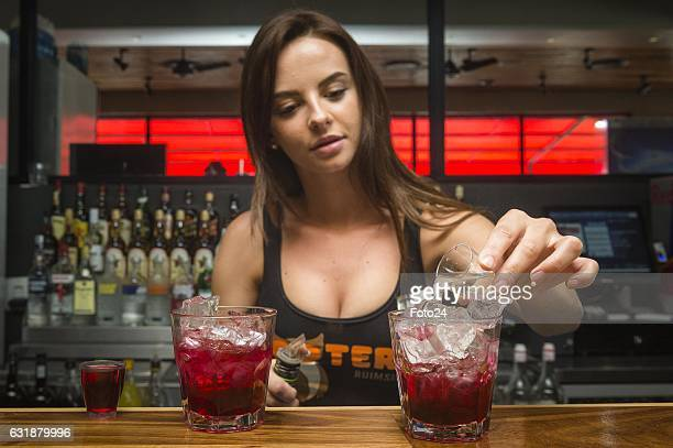 Bartender Carla De Pont prepares the Angel shot cocktails at Hooters Restaurant on January 16, 2017 in Johannesburg, South Africa. The Angel shot...