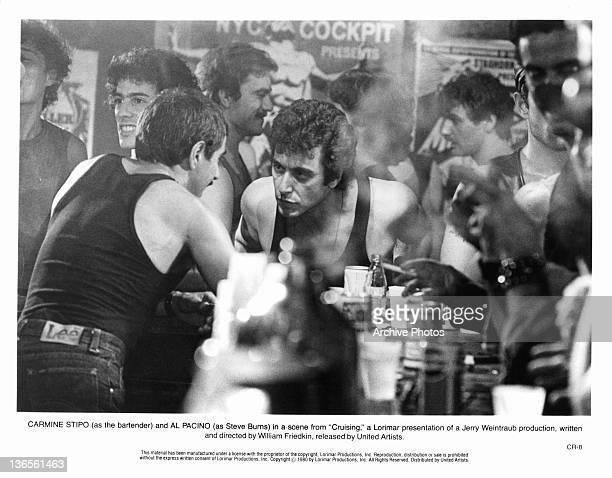 Bartender Carmine Stipo talking to Al Pacino in a scene from the film 'Cruising' 1980