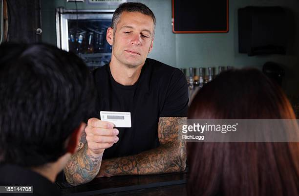 bartender checking id - identity stock photos and pictures