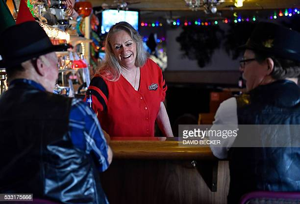 Bartender Debbie Aguilera serves customers inside the CalNevAri Casino in CalNevAri Nevada on May 15 Nancy Kidwell is a modernday pioneer of the...