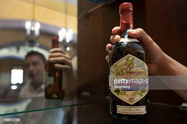 Bartender displays a bottle of Jose Cuervo Reserva de la Familia for a photograph at the Tequila Cuervo La Rojena S.A. De C.V. Distillery plant in...