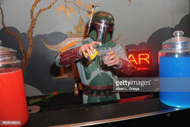 A bartender dressed as Boba Fett at the Opening Night Celebration Of Walt Disney Pictures And Lucasfilm's 'Star Wars The Last Jedi' At TCL Chinese...