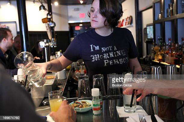 Bartender Emma Hollander slogan on tshirt sums it up for latenight restaurant workers enjoying a late Monday morning brunch at Trina's Starlite...