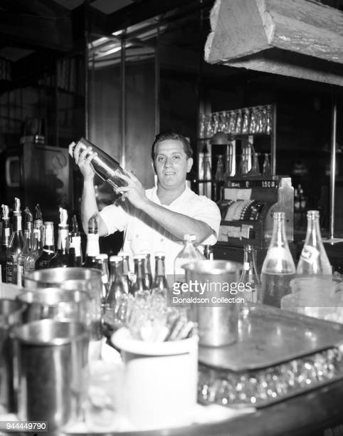 A bartender fixes a drink on September 5 1952 at Chateau Gardens in New York