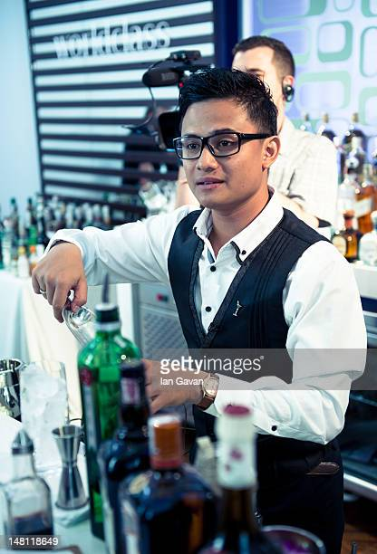 Bartender Harli Garnawan representing Indonesia competes in the Tropical Journey challenge during day 2 of the Diageo Reserve WORLD CLASS 2012 Global...