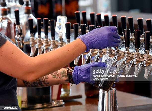 Bartender Holly Yoder pours a beer for a customer at the Sly Fox Taphouse in Wyomissing PA Thursday afternoon July 16 2020 where they are adjusting...