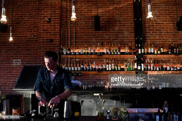 DENVER CO OCTOBER 24 Bartender J Jenson tends the bar at the new bar called SneekEazy on October 24 2017 in Denver Colorado SneekEazy with a tagline...