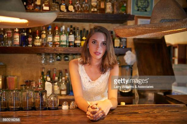 Bartender leaning on bar in restaurant