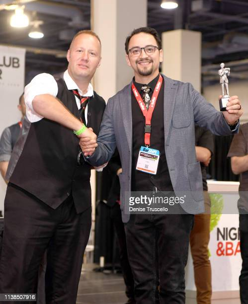 Bartender Lorenzo Garcia receives a trophy for third place in the Shake It Up Flair Competition during day two of the 34th annual Nightclub & Bar...