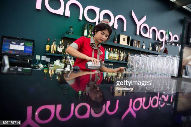 Bartender makes a drink at the Yangon Yangon bar, located atop the Sakura Tower, in Yangon, Myanmar, on Monday, June 12, 2017. When the country...