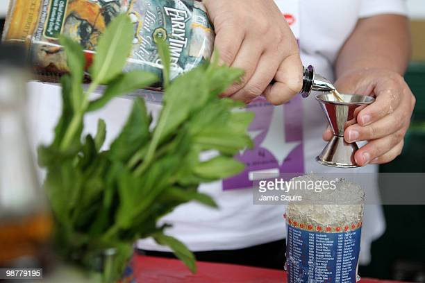 A bartender makes a mint julep prior to the 136th running of the Kentucky Derby on May 1 2010 in Louisville Kentucky