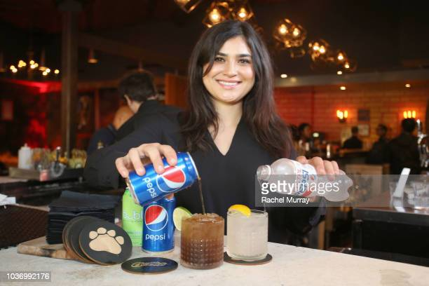 A bartender makes a Pepsi cocktail at The Flamin Hot Spot Cheetos new limitedtime restaurant with a menu inspired by chef Roy Choi at Madera Kitchen...