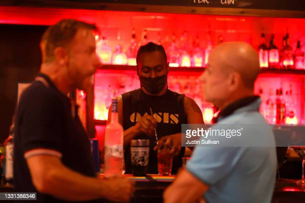 Bartender makes cocktails for customers at Oasis on July 29, 2021 in San Francisco, California. As COVID-19 begins to surge due to the Delta variant,...
