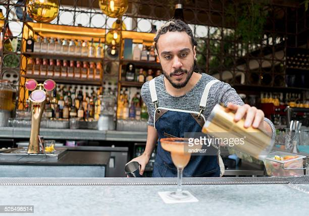 Bartender making cocktails at a bar
