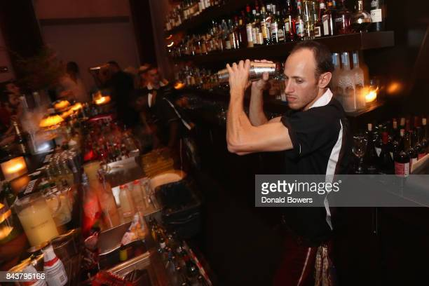 A bartender mixes a cocktail at the launch of Mission Magazine with Belvedere Vodka at Rose Bar at Gramercy Park Hotel on September 6 2017 in New...