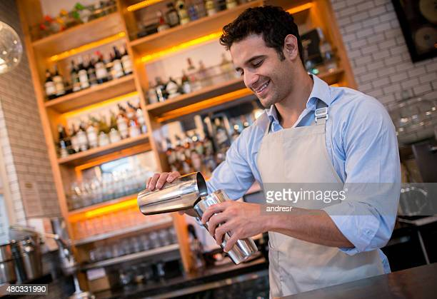 Bartender mixing drinks at a bar