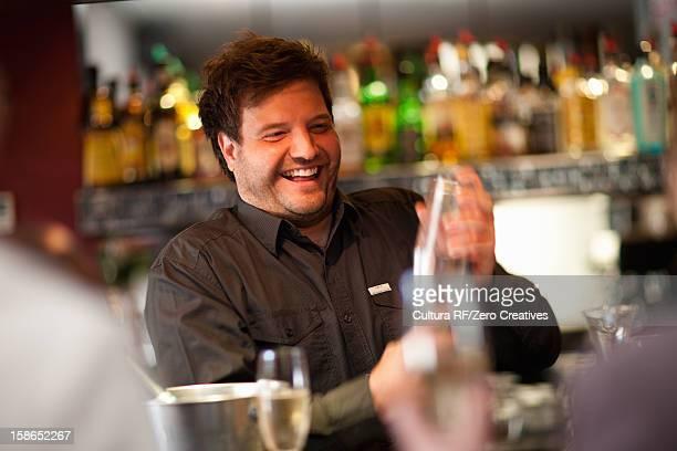 Bartender mixing drinks at bar