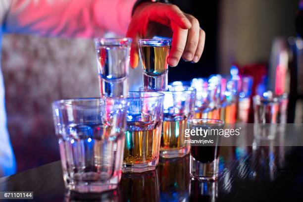Bartender mixing drinks