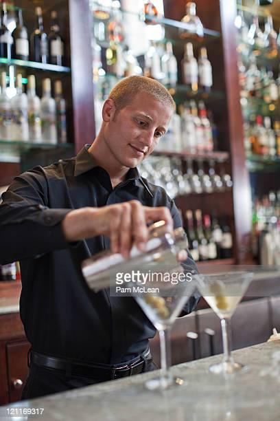 Bartender mixing martinis
