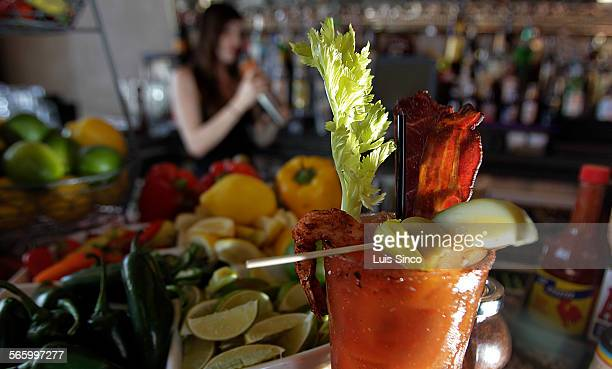 Bartender Morgana serves up Sunday cocktails at the build–your–own Bloody Mary bar of St Felix in Hollywood Bloody Marys are made from fresh produce...