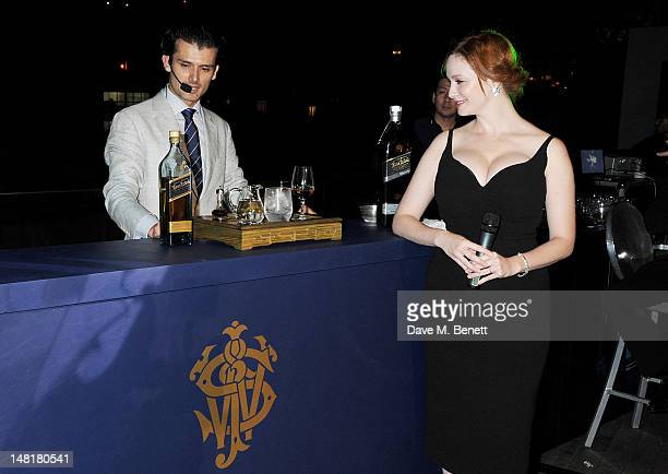 Bartender of the Year 2010 Erik Lorincz and actress Christina Hendricks attend the Johnnie Walker Blue Label Ultimate Game Changer Experience during...