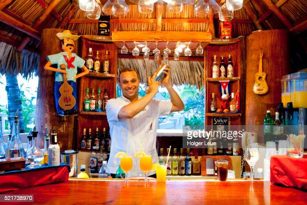 Bartender performs cocktail mixing show at Sol Cayo Coco Hotel