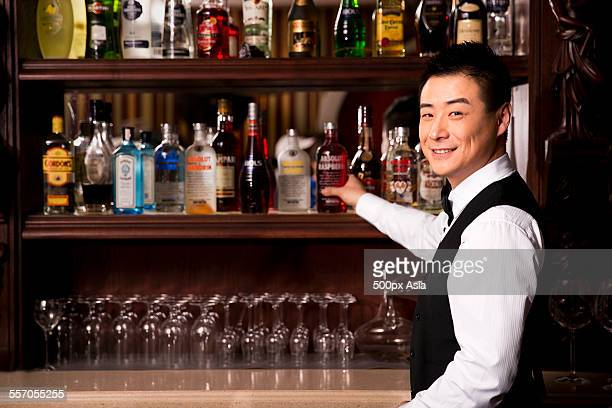 bartender - bar drink establishment stock photos and pictures