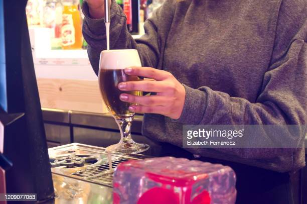 bartender pouring a beer from tap - a coruna stock pictures, royalty-free photos & images